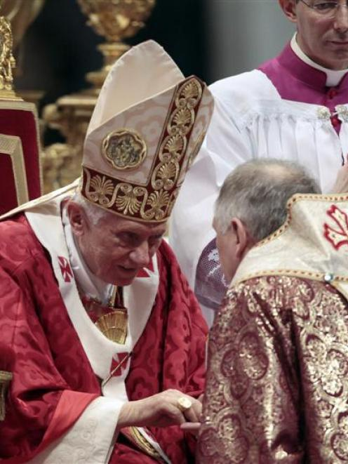 Archbishop of the Byzantine Catholic Archdiocese of Pittsburgh, William Charles Skurla (right)...