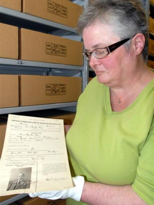 Archives New Zealand archivist Vivienne Cuff with a certificate of registration and photograph of...