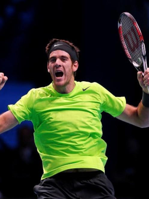 Argentina's Juan Martin Del Potro celebrates winning his men's singles tennis match against...