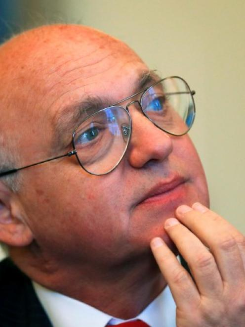 Argentine Foreign Minister Hector Timerman listens to a question during a news conference at the...