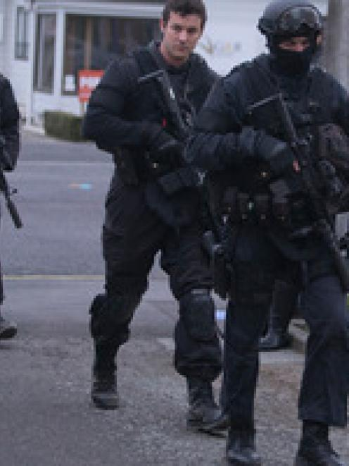 Armed Offenders Squad members return to the Ashburton Police Station after apprehending Russell...