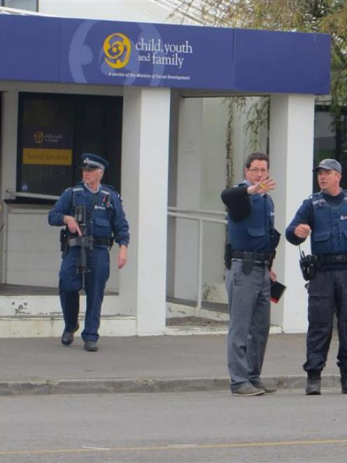 Armed officers outside the Ashburton WINZ office soon after the shooting last September. Photo by...
