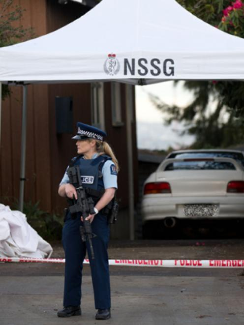 Armed police guard the scene where Connor Morris was fatally attacked. Photo: NZ Herald/Richard...