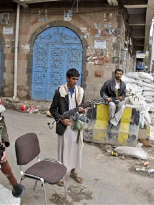 Armed tribesmen loyal to Sheik Sadeq al-Ahmar, the head of the powerful Hashid tribe, take...