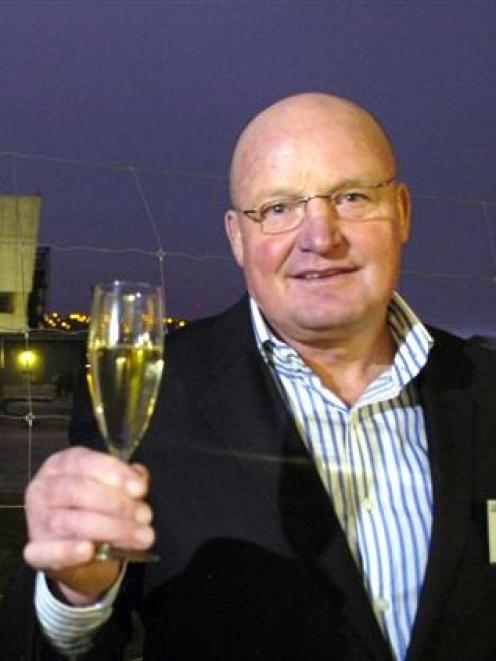 Arrow International Group Ltd director and founder Ron Anderson raises his glass at the...