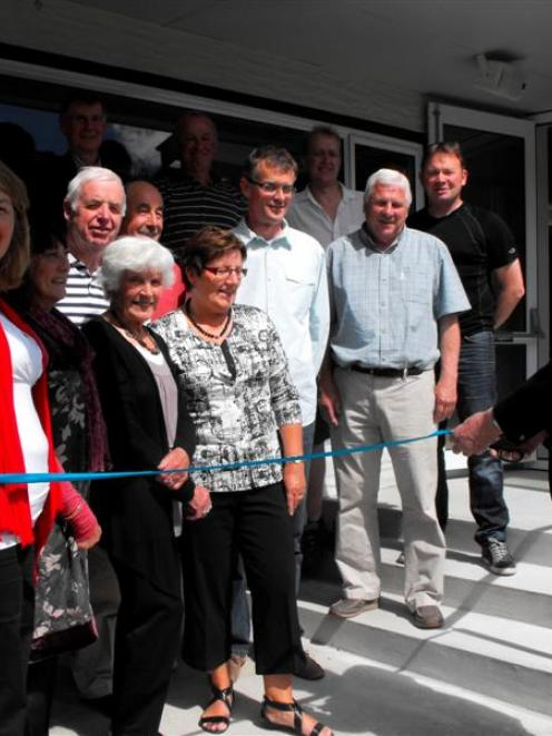 Arrowtown Bowling Club life member Taylor Reed cuts the  ribbon on  the  building's new $150,000...