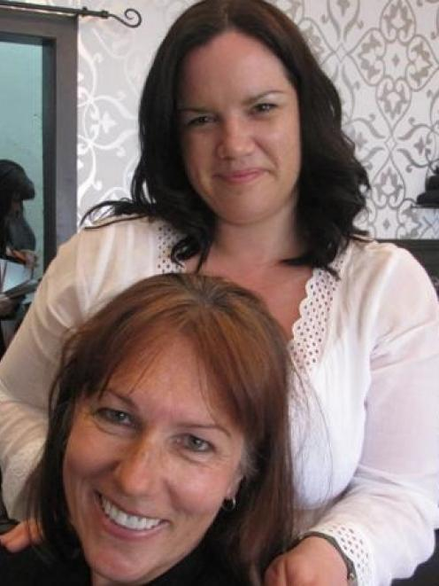 Arrowtown Hair Company owner Nikki Nash prepares to give Queenstown police Sergeant Kate Pirovano...