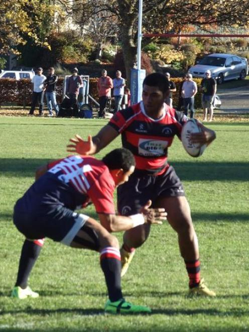 Arrowtown player Joji Ravula (with the ball) goes into battle with Cromwell. Photo by Christina...