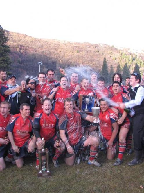 Arrowtown players and management celebrate their 23-13 win against Upper Clutha in last year's...