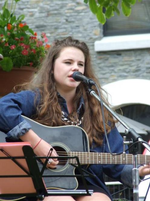 Arrowtown's Ruby Bain entertains crowds on the Village Green yesterday, part of the 2012-13...
