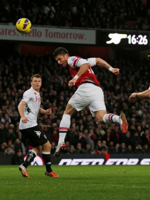 Arsenal's Olivier Giroud scores a goal to equalise in the second half of their Premier League...