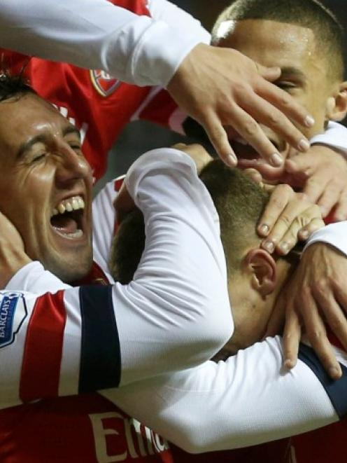 Arsenal's Santi Cazorla (L) celebrates with teammates after scoring a hat-trick against Reading...
