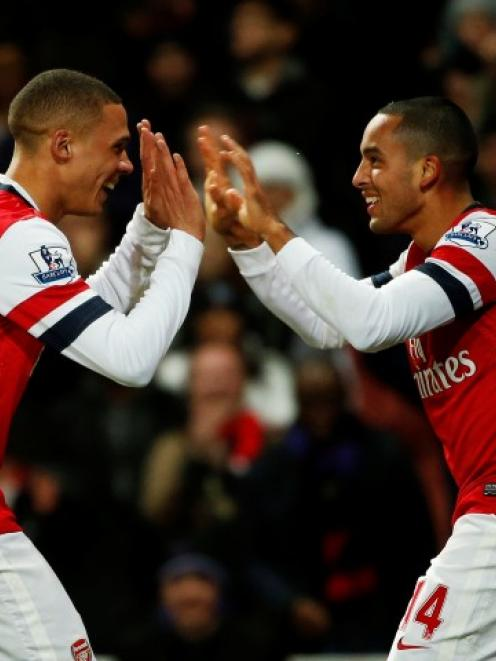 Arsenal's Theo Walcott (R) celebrates his third goal against Newcastle United with Kieran Gibbs...