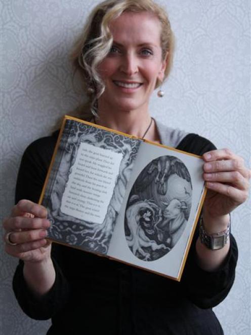 Artist Deidre Copeland with the newly-published Janet Frame novella, The Mijo Tree.