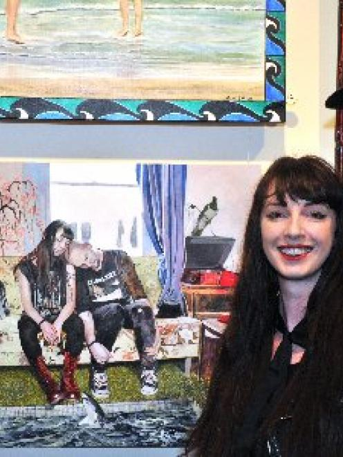 Artist Jasmine Middlebrook, of Dunedin, with her winning painting O Confine Me Not, featuring...