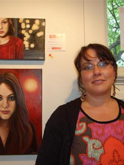 Artist Karyn Hitchman with the two paintings she submitted in the Queenstown Art Society Art...