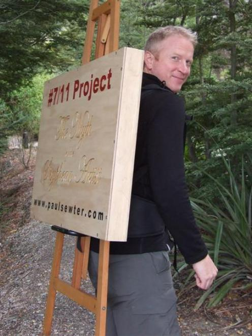 Artist Paul Sewter prepares to climb Ben Lomond on Sunday to display an artwork which is...