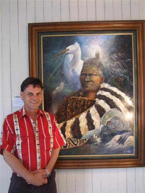 Artist Peter Jean Caley stands beside one of his paintings on display in Waimate this month....