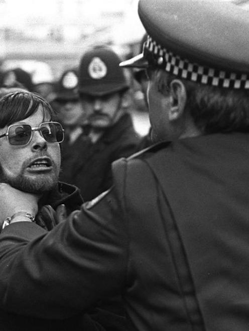 As the Springboks' bus arrives outside the Southern Cross Hotel in 1981 a policeman restrains a...