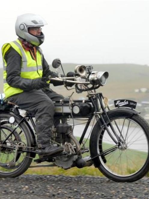 Ashley Blair rides his 1914 Humber motorcycle on Lammerlaw Rd, Waipori, yesterday. Photo by...