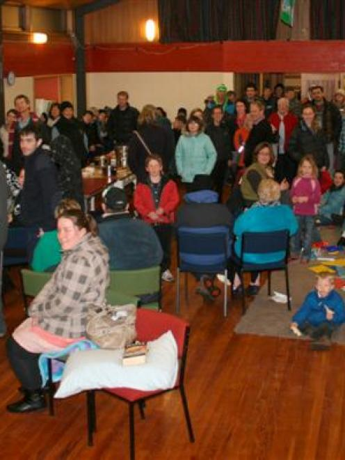 At least 220 people cram into the Waitati Hall, north of Dunedin, last night after motorists...