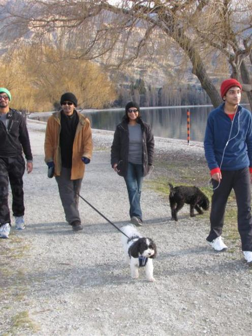 Auckland family (from left) Rehan (18), Channaka, Millie and Lasharn Weerasinghe (19), walk...