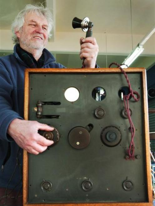 Auctioneer Kevin Hayward takes a closer look at a transmitter used to make  New Zealand's first...