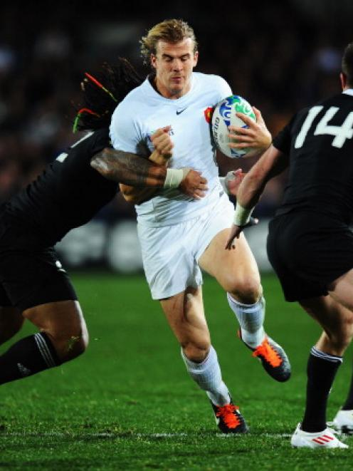 Aurelien Rougerie tries to bust through the defence of Ma'a Nonu (L) and Cory Jane during the...