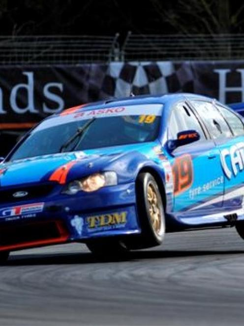 Aussie V8 Super Car driver Shane Van Gisbergen pushes the limit in his Ford Falcon during the...