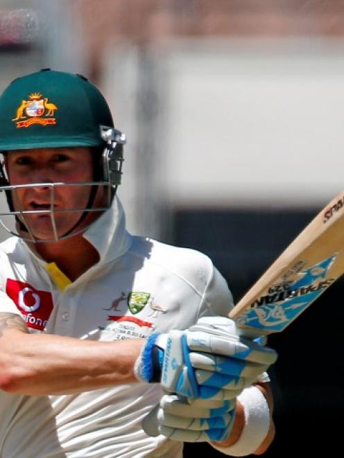 Australia captain Michael Clarke hits a boundary on day two of the second test against Sri Lanka...