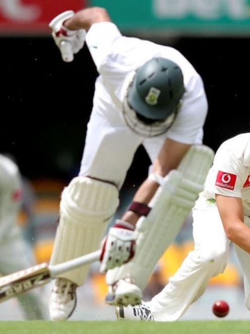 Australia's James Pattinson (R) tries to run out South African batsman Hashim Amla on day three...