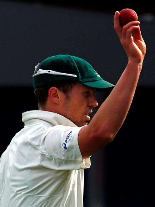 Australia's Peter Siddle acknowledges the crowd after taking five wickets during the third day's...