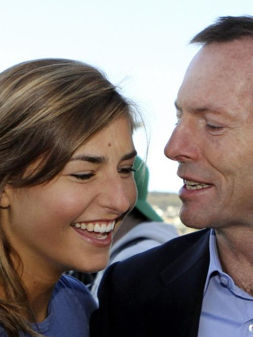 Australia's then-opposition Leader Tony Abbott talks to his daughter Frances during a visit to...
