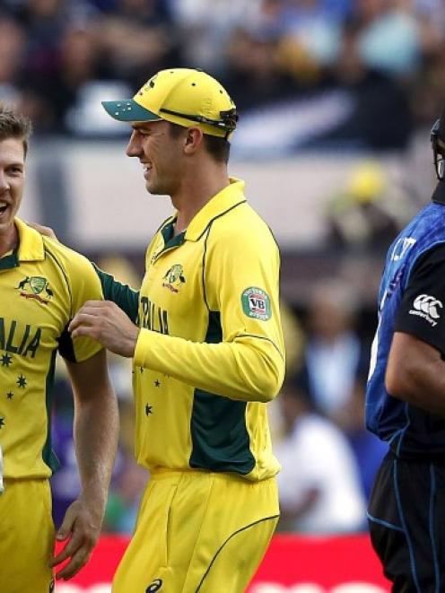 Australia wicketkeeper Brad Haddin (L) celebrates with team-mates James Faulkner (2nd L) and...