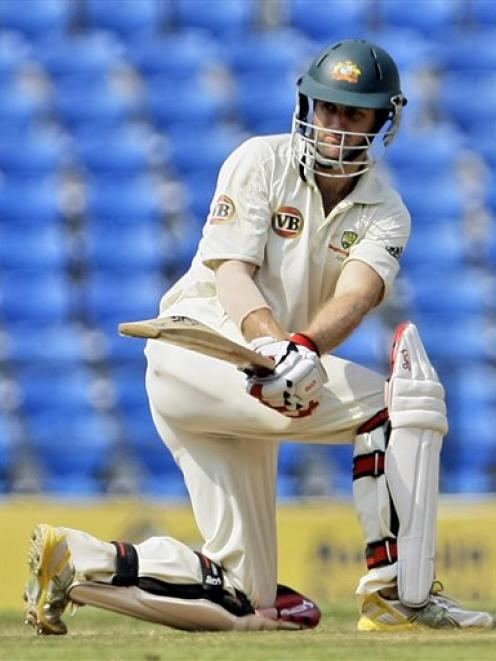 Australian cricketer Simon Katich bats during the third day of the fourth and final cricket test...