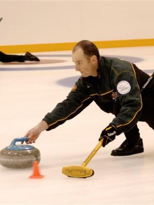 Australian curlers Laurie Weeden (left) and Ian Palangio practise at the Dunedin Ice Stadium this...