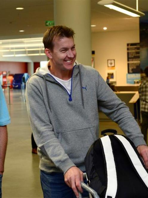 Australian fast bowler Brett Lee  (centre) is welcomed at Dunedin International Airport last...
