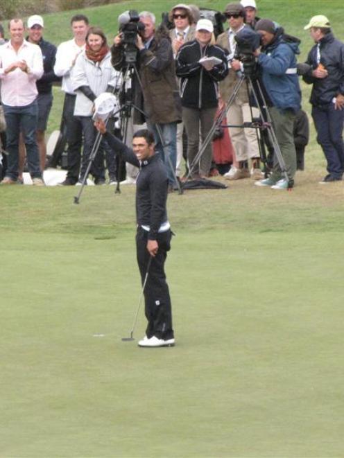 Australian golfer Dimitrios Papadatos salutes the crowd after he won the 2014 New Zealand Open at...