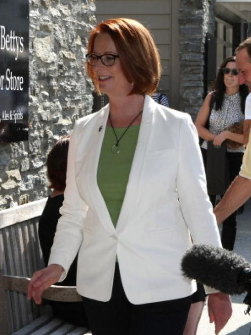 Australian Prime Minister Julia Gillard and New Zealand Prime Minister John Key meet locals in...