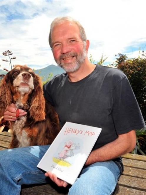 Author David Elliot at home in Port Chalmers with Henry's Map and his dog Molly yesterday. Photo...