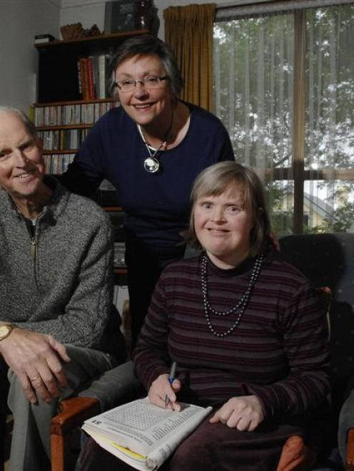 Author Huberta Hellendoorn (centre) with her husband Bart, help their daughter Miriam, who has...