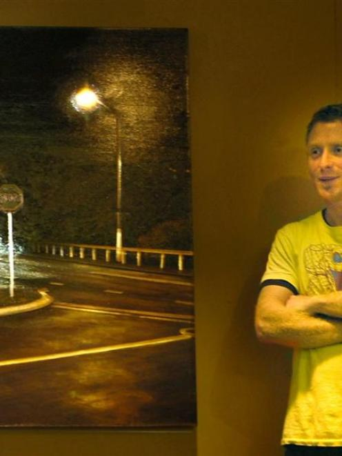 Award-winning artist Sam Foley stands next to his Opoho Intersection No. 1, a kinetic painting...