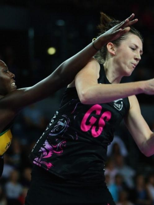 Bailey Mes of New Zealand takes a pass in front of Vangetee Williams of Jamaica in their Fast5...