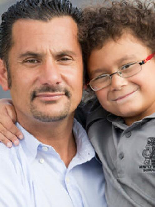 Banapa Avatea with his five-year-old son Jordan. Photo: NZ Herald