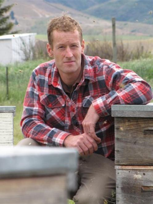 Bannockburn beekeeper Tim Wood is looking forward to warmer weather when his bees will become...