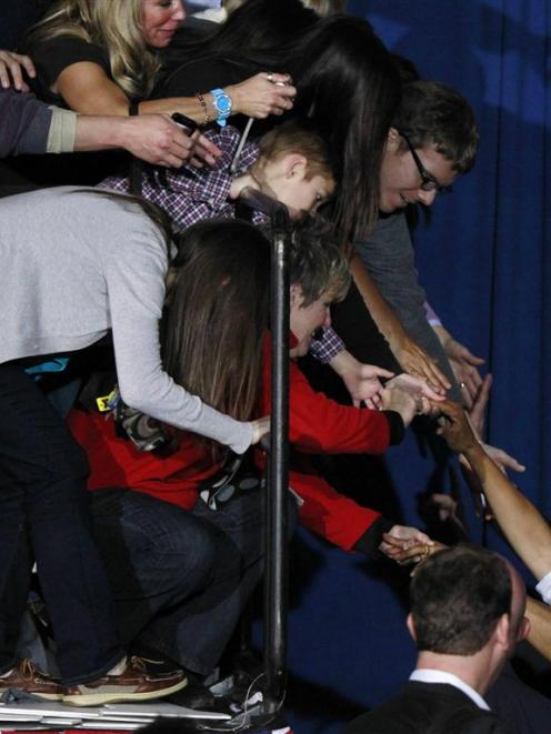 Barack Obama greets supporters during a campaign rally at Mentor High School in Mentor, Ohio....