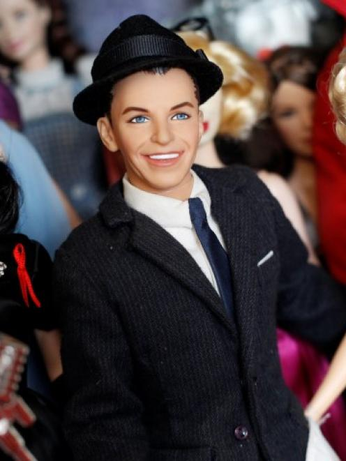 Barbie dolls (l-r) in the likeness of Elizabeth Taylor, Frank Sinatra and Marilyn Monroe are...