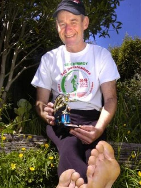 Barefoot walker William Lucas recovers at his Dunedin home this week after covering 143km in the...