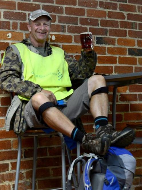 Barmy Army founding member and charity fundraiser Robin Moore enjoys a beer after completing a...