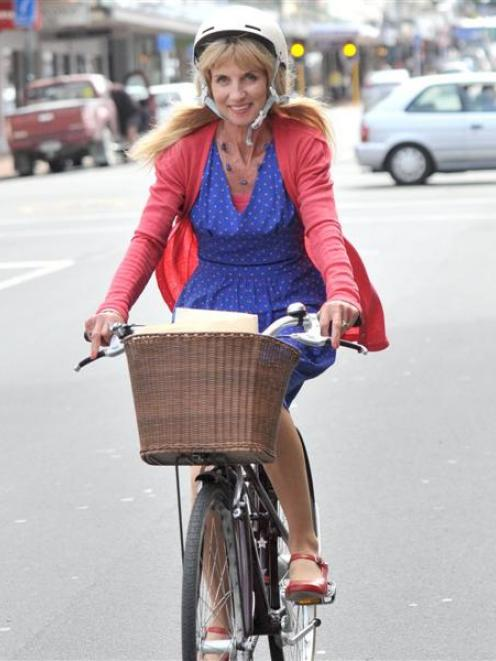 Barrister Anne Stevens cycles down Stuart St, Dunedin, this week on her way to court.  Photo by...